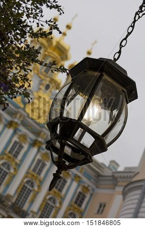 The lantern in the old style metal with glass Catherine Palace Tsarskoye Selo Pushkin Saint-Petersburg autumn the Golden domes of the Church with crosses a Church chapel Park