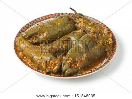Traditional Moroccan dish with stuffed bell peppers and rice on white background