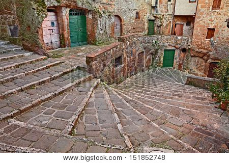 Pitigliano Grosseto Tuscany Italy: picturesque old staircase in the medieval town founded in Etruscan time.