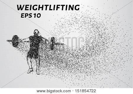 Weightlifting of particles. Athlete raises the bar in the snatch.