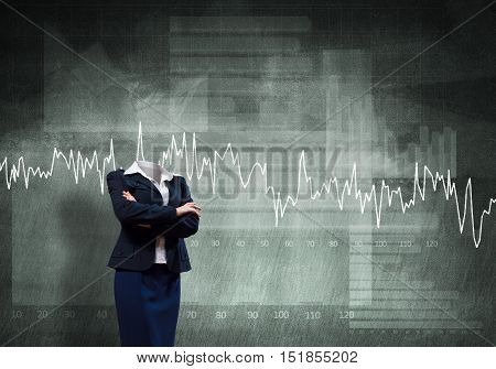 Headless businesswoman with arms crossed on chest on gray background