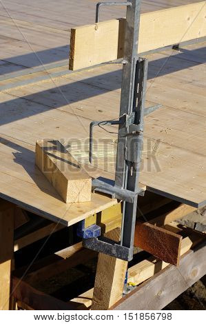 Temporary wood forms, safety handrails detail equipment.