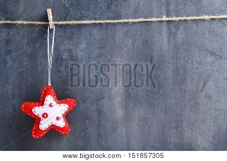 Christmas Decoration Hanging On Rope On Grey Background