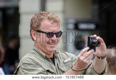 An Male Tourist Making Photo At Bern, Switzerland
