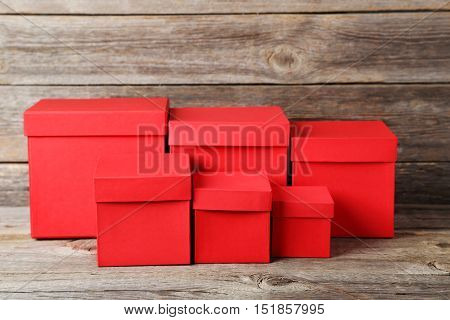rows of red boxes on grey wooden table