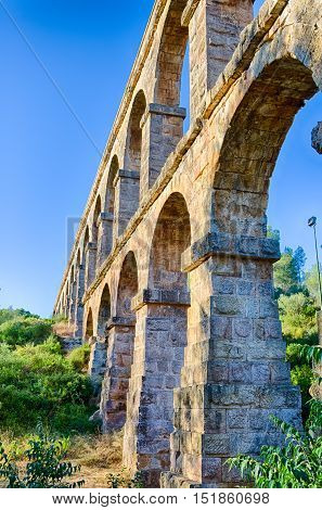 High archade of roman aqueduct near Tarragona, summer Spain