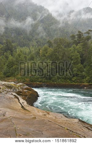 River Futaleufu flowing through mist shrouded forests in the Aysen Region of southern Chile. The river is renowned as one of the premier locations in the world for white water rafting.