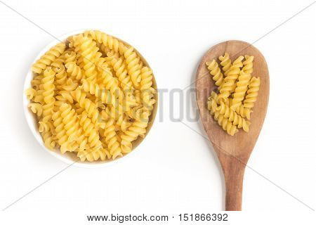 Fusilli Into a bowl isolated in white background
