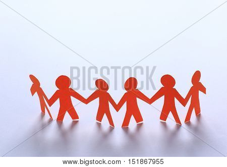 teamwork, paper people hold each other's hands on white .teamwork, paper people hold each other's hands  The photo has a free space for your text