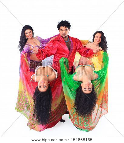 Gypsy dance group in traditional costumes performing a dance