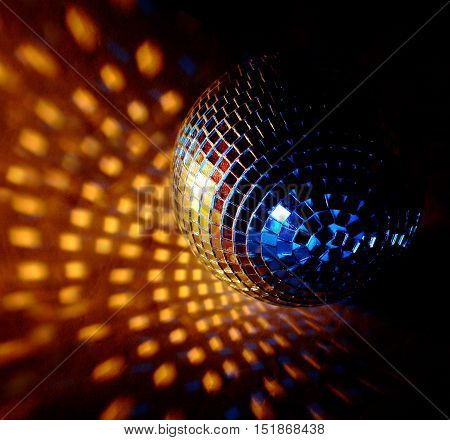 closeup of a mirrorball on a white background