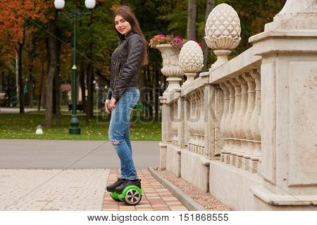 Happy Girl Standing On Hoverboard Or Gyroscooter Outdoor.