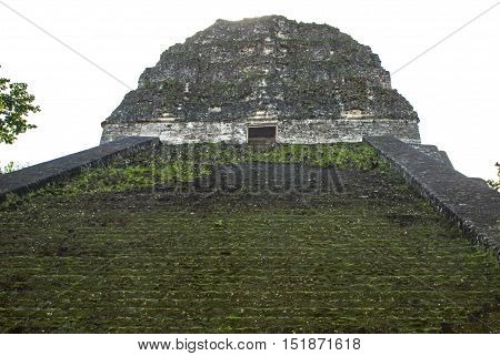 Skywards leading stairs of an ancient Mayan temple in Tikal Guatemala