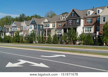 Row of town homes alone a parkway
