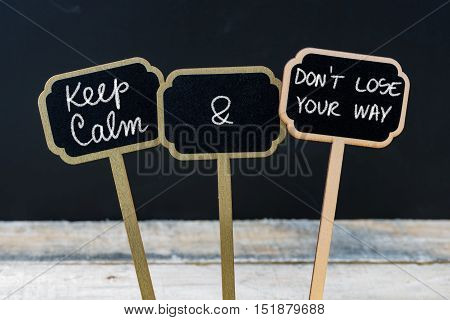 Keep Calm And Do Not Lose Your Way Message Written With Chalk On Mini Blackboard Labels