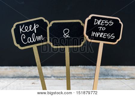 Keep Calm And Dress To Impress Message Written With Chalk On Mini Blackboard Labels