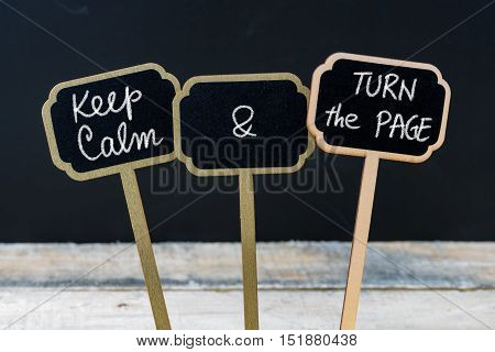 Keep Calm And Turn The Page Message Written With Chalk On Mini Blackboard Labels