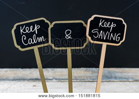 Keep Calm And Keep Saving Message Written With Chalk On Mini Blackboard Labels