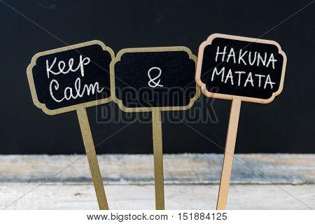 Keep Calm And Hakuna Matata Message Written With Chalk On Mini Blackboard Labels