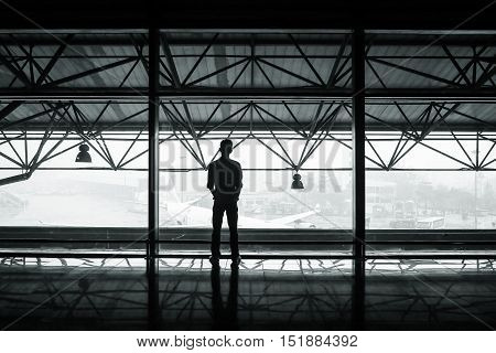 black and white image of airport hanger rafters