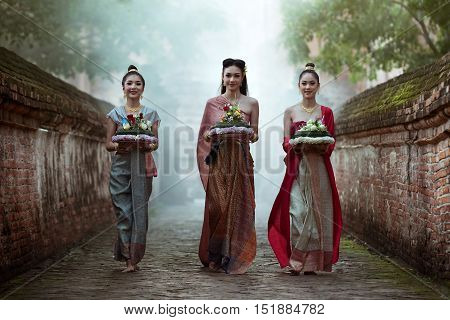 Asia women in Thai dress traditional: Noppamas Queen Contest in Loy kratong tradition at Wat Phutthaisawan (Phutthaisawan temple), Ayutthaya province, Thailand