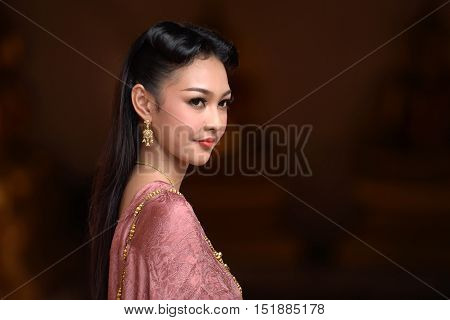 Asia woman in Thai dress traditional: Noppamas Queen Contest in Loy kratong tradition at Wat Phutthaisawan (Phutthaisawan temple), Ayutthaya province, Thailand