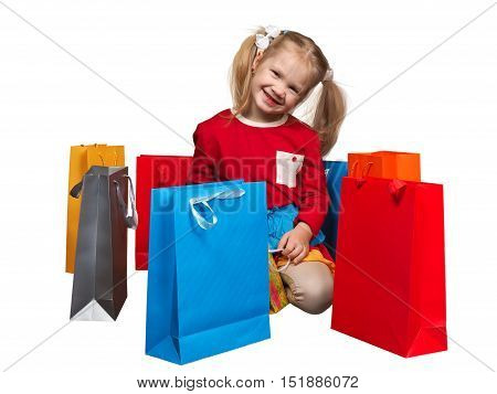 Happy little girl and a lot of shopping bags raznovetnyh. Isolated white background. Concept - the purchase sale goods for children shopping
