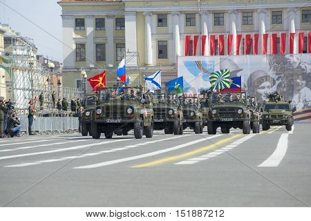 SAINT PETERSBURG, RUSSIA - MAY 05, 2015: The group on the UAZ-469 opens the passage of military equipment. Rehearsal of the Victory parade in St. Petersburg
