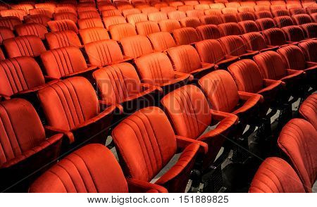 Cinema and music with audience comfortable red seats