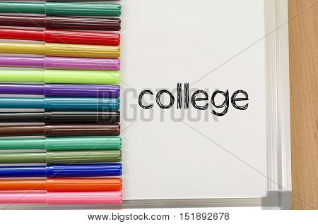 Felt-tip pen and whiteboard on a wooden background and college text concept