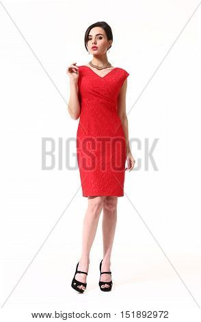 woman with updo hair style in fokrmal party red decolette dress high heels shoes full length body portrait standing isolated on white