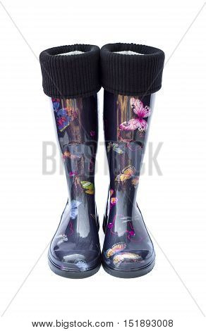 Warm black female rubber boots with butterflies isolated on white background with clipping path