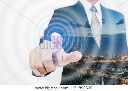 Double exposure businessman pointing finger to screen