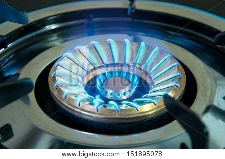 Close up blue flame on gas stove, kitchenware