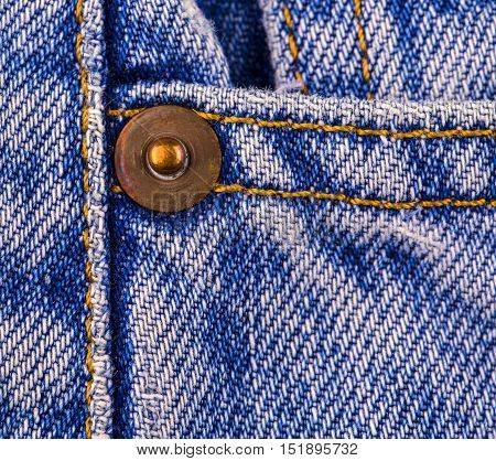 Close up of the button on the old blue jeans