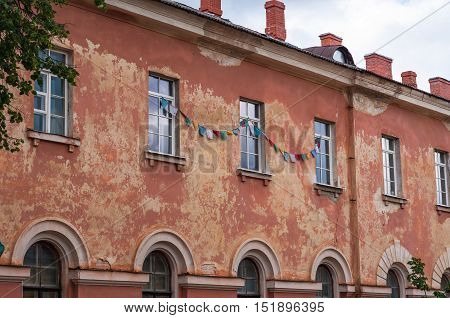 Old soviet abandoned building with windows and chimneys