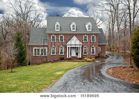 Brick Country Home On A Rainy Day