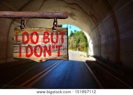 I do but I don't motivational phrase sign on old wood with blurred background