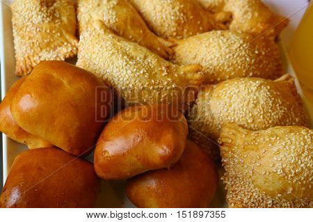 country pies with meat and seasame seeds close up photo
