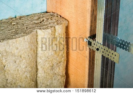 attic insulation with rock wool on a green background