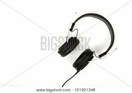 Black Headphones Against A Light Coloured Background