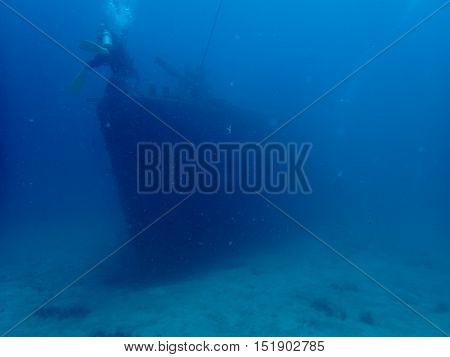 Blur shipwreck with divers, HTMS Prab Shipwreck