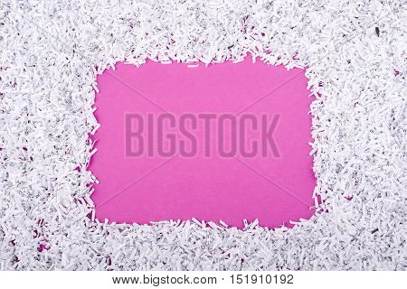 pink background with shredded paper frame around