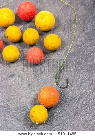 Carp Hook Boilies on black background .