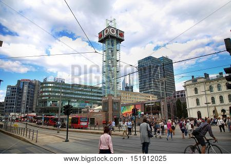 OSLO NORWAY - AUGUST 18 2016: People walking on wonderful Plaza in front of Oslo Central station on nice sunny day in Oslo Norway on August 182016.