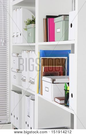 Bookcase With Folders In The Office Businessman