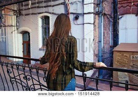 Rear view of woman looking at the city sadness loneliness
