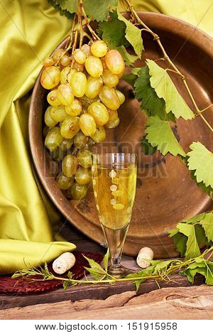 Vintage Wine Glass Against Background Cluster Of Grapes And Cooper Basin