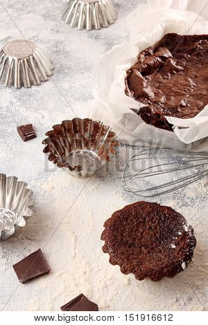 Still Life With Chocolate Cupcake And Baking Utensils