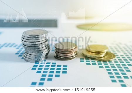 Coin Stacks On Paper Of Financial Graph. Graphics Icons, Worldwide Stock Exchanges. Business Concept